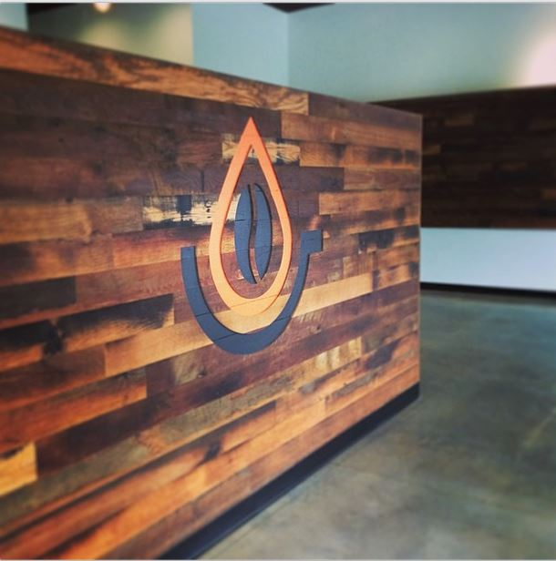 This cafe used reclaimed Settlers' Plank mixed hardwoods to highlight their  logo. - Pioneer Millworks Now Offering Products Beyond Reclaimed Wood Flooring