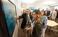 The Ronan Center for Financial Technology at Husson University feature touchscreen technology that allows students to conduct investment research.