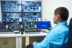 CCTV monitoring executive watching live videos