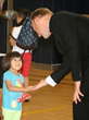 Father Thomas, LC greets a Everest preschool student.