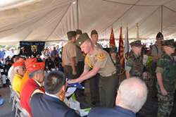 YM/SgtMaj Blake DeWeese, National Young Marine of the Year, presents a flag to the Navajo Code Talkers on National Navajo Code Talkers Day in Window Rock, AZ.