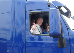 "Senator Ron Johnson gives a ""thumbs up"" after his ride in a new Model 579 Peterbilt"