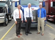 Eric Jorgensen, Senator Ron Johnson and Herman Goth in front of new Model 579 Peterbilt