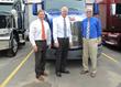 Eric Jorgensen, Senator Ron Johnson and Herman Goth in front of new Model 579 Peterbilt