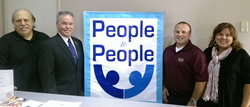 Joe Allen, President of the Board of Directors of People to Peop, Rockland County Executive Ed Day, David Damato of Corner Bakery Cafe and Diane Cerratore, Executive Director of People to People
