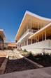 A bioswale filters rainwater through the center of The Girls' School of Austin campus and is an important water control feature.