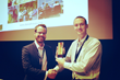 Nicholas McBride (left) of CKM Advisors accepts the first place award for the 2014 Business Process Intelligence Challenge in Eindhoven, The Netherlands