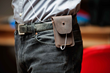 iPhone Spinn Case—in action, with belt clip and earbuds attached