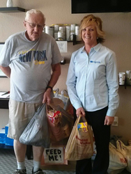 Don Abbott from the Food Pantry with Cambi Reed, office manager