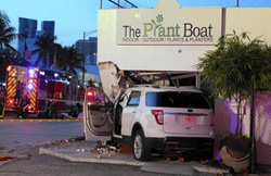 SUV Crashes into Plant Boat