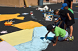 """Mayo Elementary School students paint a map of the United States on the school's playground Saturday, Sept. 6, at the Timberland and Shiekh Shoes """"Back to New"""" beautification project."""
