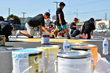 """Mayo teachers and students and brand representatives paint a map of the United States on the school's playground Saturday, Sept. 6, at the Timberland and Shiekh Shoes """"Back to New"""" beautification."""