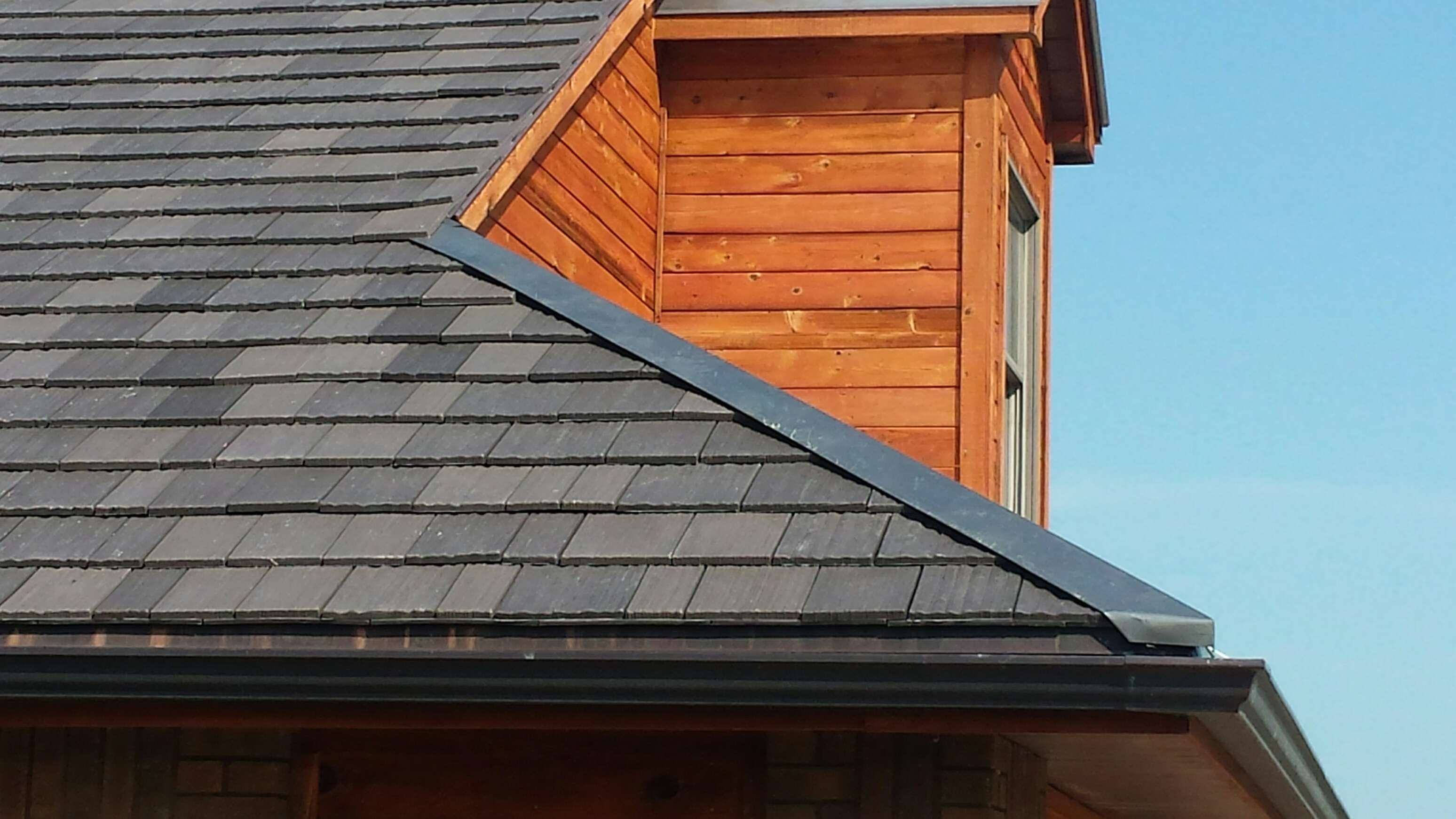 Get your roof ready for hurricane season 2015 for Polymer roofing shingles
