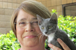 Nurse manager Leslie Ware and kitten Moxie.