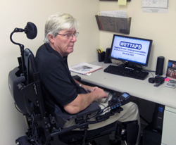 Photo of Harry Kember at his computer.