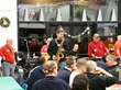 Tim McLoone and members of Holiday Express performing at Eva's Village.