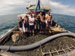 The crew on the deck of the RV Aqua Quest with a load of valuable copper ore - Photo by Aqua Quest Films