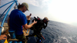 Filmmaker Michael McCabe photographing Captain Mayne jumping from the deck of the Aqua Quest - Photo by Aqua Quest Films