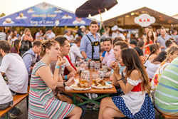 Attendees at last year's Brisbane Oktoberfest enjoying some German pork knuckles