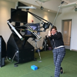 Lori Heller taking a Lesson on the RoboGolfPro