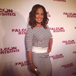 "Laila Ali carries Jill Milan 450 Sutter Clutch to the premiere of her film ""Falcon Rising"" Sep 5, 2014 in New York."