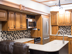 Lippert Components, Inc. (LCI®) announced today the introduction of custom glass printing capabilities, and will debut custom printed glass kitchen backsplashes during RV Open House Week.