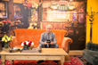 "Actor James Michael Tyler, who played the famously deadpan barista ""Gunther"" on FRIENDS, on the iconic orange couch from the show at the pop-up replica of Central Perk in NYC."