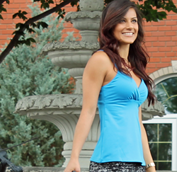Edmonton model Christine Rahman wearing aqua blue yoga cross over tank.