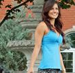 Edmonton model Christine Rahman wearing aqua blue yoga cross over tank.