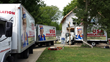 Three USA Insulation trucks in front of Haworth home.