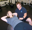 Prescription Fitness owner Joe Butler works with a client.