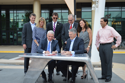 Infinitive CEO Denis McFarlane signs lease for new world headquarters at One Loudoun