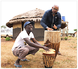 "Okello Sam and Forest Whitaker – who met on the set of ""The Last King Of Scotland"" – practice on Ngoma drums in Uganda this summer. Whitaker is the honoree at Hope North's gala in NYC on Nov. 1."