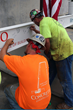Clayco Inc. construction workers sign the final beam.