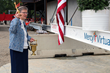 Sister of Mercy Claudia Ward blesses the final beam before it's raised.