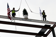 The final beam of the world's first virtual care center is hoisted into place.