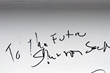 """Mercy's Shannon Sock, executive vice president and chief financial officer, signed the final beam """"To the Future."""""""