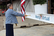Sister of Mercy Claudia Ward blesses the final beam before it is hoisted into place.