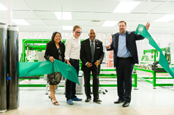 Theresa Mendoza, Office of Economic Development, Mike Pickford, RavenBrick, Denver Mayor Michael B. Hancock, and Alex Burney, RavenBrick cut the ribbon for the RavenWindow Automated line launch
