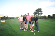 Former Utah Jazz player Mehmet Okur and two Utah Jazz Dancers pose on the first tee with a team of golfers.