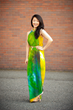 Creative Director Roshena Minnes models Walnutte's Tropical Illusion luxury scarf as a dress