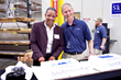 "Demetria ""Lynn"" Strickland and Skills Inc. CEO, Todd Dunnington celebrate launch of AJAC's Precision Metal Fabrication Apprenticeship Class at Skills Inc. in Auburn, WA."