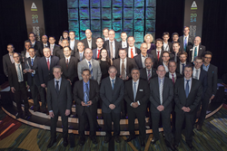 Winners and presenters commemorate the night with a group photo after the 2014 Prism Awards for Photonics Innovation, at the close of a gala banquet.
