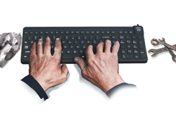 Industrial user typing on Really-O-Cool Oil Resistant Waterproof Silicone Keyboard ROC/B5 from Man & Machine