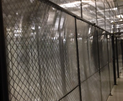 The Cool Shield aisle containment solution converts cage walls into a solid vertical partition