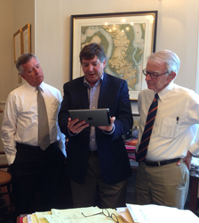 Atlatl Software Co-founder Rob Honeycutt demonstrates the operating ease and innovation behind Atlatl SRP 3D virtualized configure, price, quote (CPQ) module. Charleston, S.C. Mayor Joseph P. Riley, Jr. and his Senior Advisor Lawrence Thompson  watch.
