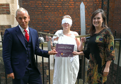Photo caption: Judge Rinder (pictured with Lady Justice and LLST Deputy Chief Executive, Natalia Rymaszewska) is quick to book his place at the LLST's Dazzling Decade party, sponsored by Lexacom.