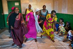 Adolescent girls in a BRAC empowerment club in Tanzania perform a dance to raise awareness about HIV.