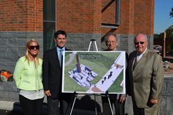 Bucks County community leaders and the artist who designed the sculpture pose for a picture with the rendering.