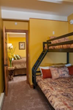 The budget-friendly one bedroom plus bunk beds suite at Antlers at Vail includes a full kitchen and fireplace living room, ideal for family vacations.